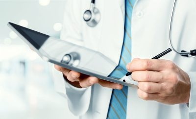 doctor-with-tablet-cropped_513892576-1200